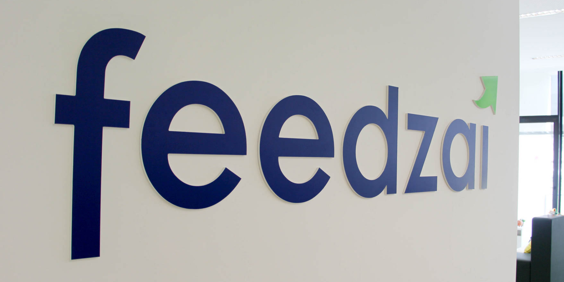 photo of Feedzai's logo on a wall